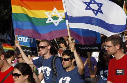 Participants hold flags during the gay pride parade in Jerusalem